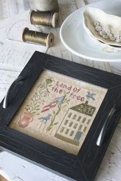 Awesome stitchy piece + frame with handles added to it = stitchy tray! Love it.