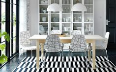 BJURSTA extendable table in birch veneer seats 4-8 and VILMAR chairs in white/black with chrome legs