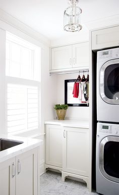 Maybe stack machines to get more space?    Google Image Result for http://www.styleathome.com/img/photos/biz/sah/laundry-rooms-sophisticated.jpg