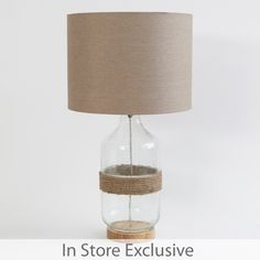 Add a touch of nautical charm to your home with this gorgeous Sailor lamp! Featuring a stylish glass base with rope and timber detail, the Sailor lamp has a timeless coastal feel, and the neutral tones look stunning in any décor.