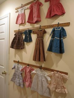 Vintage Doll Clothes Displayed By Clips on Yardsticks