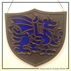 I made a series of stained glass dragon shields with Tableaux Faux Iron frames and textured glass. Here is blue.