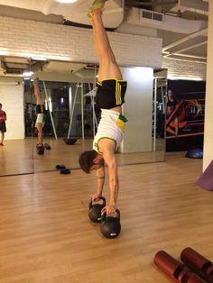 Handstand with kettlebells