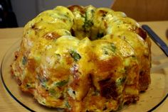 Bundt of Doom  ;D  (Mix 12 Beaten Eggs, 3/4 Cup of Milk, Seasonings, 1 Loaf of Cubed French Bread, 1 Pound of Shredded Cheese, 1/2 Cup Grated Parmesan, 1 Bunch Par-Cooked Asparagus, 1 Cup Baby Spinach Lightly Chopped, Ham, Chicken or Prosciutto If You Like, Pour Into Spritzed Bundt Pan, Just Before Baking Slowly Pour 1/2 Stick of Melted Butter Over All, Bake at 350 Degrees F For 45-60 Minutes)