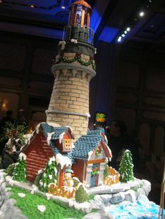 Part of entry Hidden Wonders, each brick individually made out of white gingerbread paste and constructed with royal icing, house also gingerbread with modeling paste roof and royal icing decorations. | Gingerbread Exchange