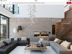 Salón doble altura con pared piedra