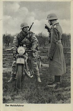 A dispatch rider getting final instructions before heading out on his assignment on his motorcycle. The caption 'Der Meldefahrer' translates in English as 'The reporting driver'