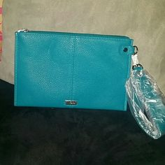 Thirty One Via Noon Teal Affair Pebble Wristlet Adorable teal wristlet from thirty one. New with tags! This is only available as a hostess deal but now you can have it! Listing is for wristlet only... Purse is available in my other closet listings! Bundle and save! :) Feel free to make a reasonable offer using the Offer button! thirty one Bags Clutches & Wristlets