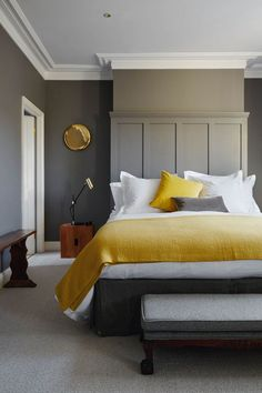 Mustard textiles are used to complement the walls painted in Farrow & Ball's 'Mole's Breath'.