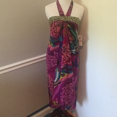 Summer dress SALE!! 🎉🎉 Gorgeous, new with tags silky summer dress. Authentic icon Dresses Backless