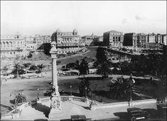 Cartão postal com vista panorâmica do teatro Municipal, detalhando o Parque Anhangabaú, os palacetes gêmeos , a praça do Patriarca com o viaduto do chá e o Hotel La Rotisserie em 1929.