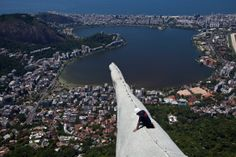 2014 Lightening stuck Christ the Redeemer statue in Rio.Arm with a view: A construction worker can be seen on the arm of the famous statue which is tall Christ The Redeemer Statue, Powerful Pictures, Adventure Is Out There, Aerial View, Beautiful World, Beautiful Things, Travel Inspiration, Funny Pictures, Funny Pics