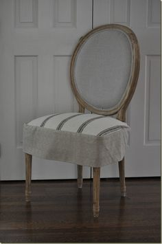 Love the slip covered seat. Made from an oversized linen like cloth napping with a skirt attached. Removable and washable.