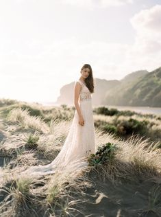 Raw and organic bridal inspiration at Bethells Beach - a rugged black sand beach in Auckland, New Zealand. Featuring a custom Gossamer wedding gown.