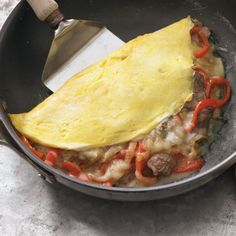 Philly Cheesesteak Omelet with Onions and Bell Peppers