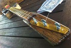 Guitar builder John Toomey has found a way that not only looks cool but functions well. The metal plate on the head stock appears to be what gives the tuners stability when the bolt is tight against the brass plate, you can be sure it's not moving or slipping out of tune.