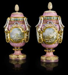 A pair of finely painted and modeled Sevres style porcelain covered urns late 19th century