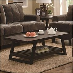 Craft a warm and inviting living room atmosphere by adding this coffee table to your décor. Finished in a rich brown this table includes a decorative slatted bottom shelf perfect for storing books ...