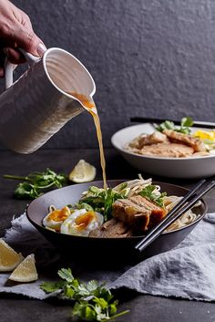 """<p>A simple bowl of roasted pork belly ramen with noodles in a deeply flavourful broth.</p> <p><a href=""""http://simply-delicious-food.com/pork-belly-ramen/""""><em><strong>Get the recipe here!</strong></em></a></p>"""