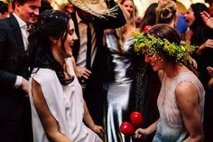 Mexican weddings can get quite rowdy—props were given out (hence all the straw hats), we had maracas on every seat, and cracked confetti-filled eggs on people's heads on the dance floor. Here Chufy and I are having a major dance session!