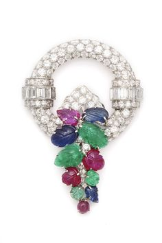 Platinum and pavé diamond-set circular brooch, with multi-colored carved gemstone leaves.    American, circa 1930.