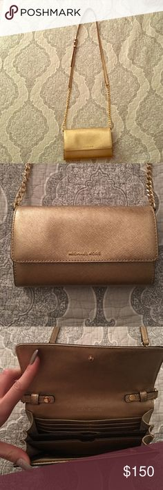 Michael Kors wallet on a chain Used for 2 weddings, amazing condition! Can remove the strap to use as a regular wallet. Has 6 card slots and room for any iPhone (my 6+ fits in there)! Please serious offers only and no trades! MICHAEL Michael Kors Bags Crossbody Bags