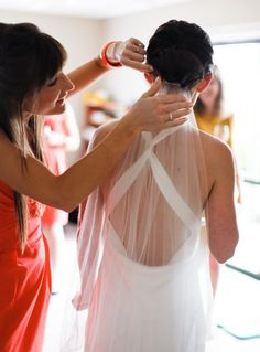 Must-have family moment: Bride's sister putting on the veil
