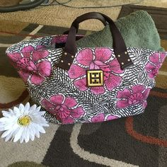 """Tommy Hilfiger tote  Cloth tote with big pink flowers excellent condition bottom of bag is 14 """"long by 6.5"""" wide top of the bag is 22"""" longgold embellishments and feet Tommy Hilfiger Bags Totes"""