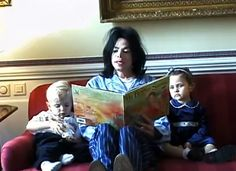 Michael Jackson reading to his son Prince Michael (aged 3) and daughter Paris (aged 2) in 2000.