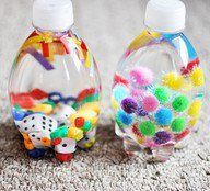 This is easy to make with small empty water bottles. Just fill with different things (add water if they're older) and glue the lid!