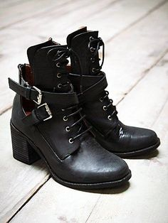 Cool, easy, black leather boots w/ cuts outs & just enough heel to dress up or down, versatile for all seasons; Admiral Ankle Boot