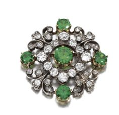 DEMANTOID GARNET AND DIAMOND BROOCH, LATE 19TH CENTURY. Set with circular-cut demantoid garnet, single- and circular-cut diamonds, detachable brooch fitting.
