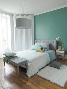Dormitorio en verde menta