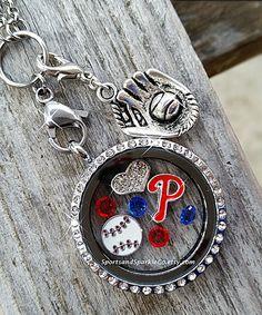 Check out this item in my Etsy shop.  Phillies baseball locket.  https://www.etsy.com/listing/216793958/baseball-floating-keepsake-glass-living