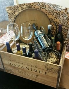 Specialty Wine Gift Basket for Fundraiser Raffle. Includes 10 bottles of wine from our state, a serving tray, 2 wine glasses, a wine bottle display holder and a beautiful, rustic crate.