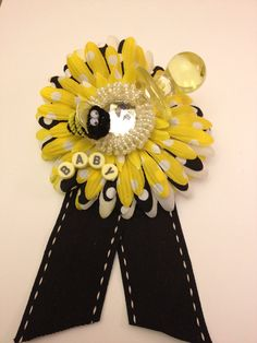 Mommy-to-Bee  Shower Corsage. Yellow and black,  gender neutral baby shower. Perfect for gender reveal or bee theme showers. via Etsy