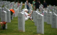 Evelyn Shepherd of Colonial Beach touches the gravestone of her late husband, Korean and Vietnam wars veteran Clarence Shepherd, during her visit to Quantico National Cemetery in Triangle, Va., on Sunday May 24, 2009. (AP Photo/Aleks Dolzenko, News & Messenger)