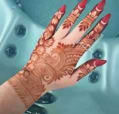 Lovely henna design inspired by from The negative leaves and lotus are really well done! Rose Mehndi Designs, Simple Arabic Mehndi Designs, Henna Art Designs, Modern Mehndi Designs, Mehndi Design Pictures, Wedding Mehndi Designs, Mehndi Designs For Fingers, Beautiful Henna Designs, Latest Mehndi Designs