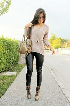 Beige knit and heels and black leather pants. Gold accessories.