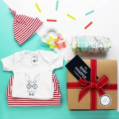 'Really Useful' Baby Hamper, Large by The Baby Hamper is filled with a variety of funky and modern baby gifts that are suitable for a boy or girl! #babyhampers #babygifts #babyboygifts #babygirlgifts #babyshowergifts #babygiftsuk #babyboyhamper #babygirlhamper #babyshowerhamper #bestbabygifts #genderneutralbabygift #funkybabygift #brightbabygift #unusualbabygift #uniquebabygift #babyhampercompany Unisex Baby Gifts, Newborn Baby Gifts, Baby Girl Gifts, Baby Shower Presents, Baby Presents, Baby Shower Gifts, Unusual Baby Gifts, Best Baby Gifts, Baby Shower Hamper