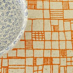 fences  screen printed fabric in orange zest by summersville, £5.00