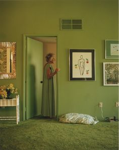 """Mom in Doorway, 1992 from """"Pictures from Home"""" by Larry Sultan"""