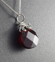 A unique, handmade, wire wrapped pendant with Garnet. Pendant was designed and made by Me, using an extremely labor-intensive and precise wire-wrapping technique, with sterling silver 925, 930 and 999. Dimensions of pendant: length: 2.2 cm 0.86 inch width: 1.5 cm 0.59 inch You receive this unique pendant in jewelry box, so it is ready to be a gift. ---On this auction You buy pendant with chain (40 cm, 15.74 inch).---- Refunds and Exchanges: If you are not satisfied with your purchase f...
