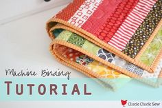 Machine Binding Tutorial-Cluck Cluck Sew So I'm going to skim over binding basics fairly quickly in order to share with you how I machine bind my quilts to look almost hand sewn. First you'll need to square up the edges of your quilt. Quilting Tips, Quilting Tutorials, Machine Quilting, Quilting Projects, Sewing Tutorials, Sewing Hacks, Sewing Crafts, Sewing Projects, Tutorial Sewing