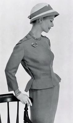 Elegant day suit with interesting button details by Carven, hat by Cècile Billard, L'Officiel, 1957