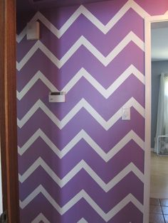 Contact paper chevron wall for the hallway. This would be a fun idea for one wall in kids bedroom!