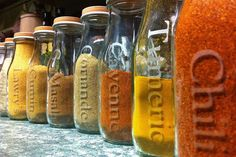 Recycled Frapp bottles also make great spice holders, since they are slim, easily accessible, and have wide mouths that will easily fit measuring spoons (unlike many spice bottles). The stencil lettering adds a practical, modern touch to these bottles! - Mommy Scene Blog