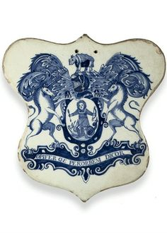 A London Delft blue and white shield-shaped pill-tile, late 17th Century