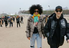Julia Sarr-Jamois in a Loewe scarf and Alastair McKimm in a North Face coat