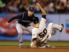 Colorado Rockies shortstop Josh Rutledge, left, tags out San Francisco Giants' Matt Duffy on an attempted steal of second base in the fourth inning of a baseball game Tuesday, Aug. 26, 2014, in San Francisco. (AP Photo/Ben Margot)
